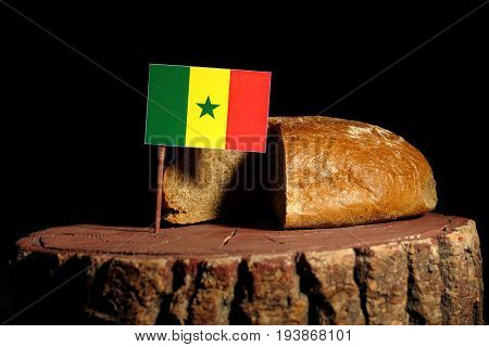 Senegal Flag On A Stump With Bread Isolated