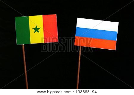 Senegal Flag With Russian Flag Isolated On Black Background