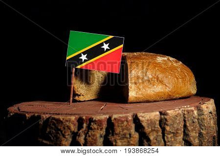 Saint Kitts And Nevis Flag On A Stump With Bread Isolated