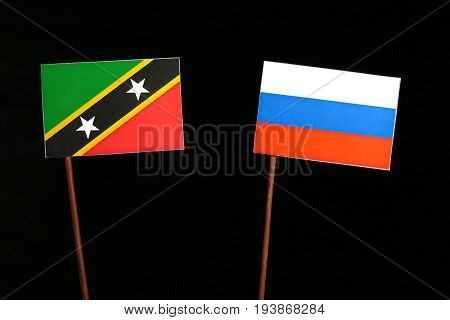Saint Kitts And Nevis Flag With Russian Flag Isolated On Black Background