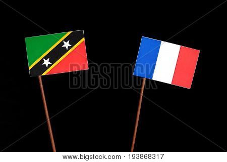 Saint Kitts And Nevis Flag With French Flag Isolated On Black Background