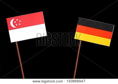Singaporean Flag With German Flag Isolated On Black Background