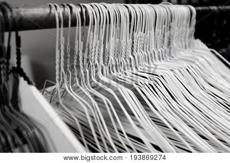 Hangers in a row on a bar for hanging clothes