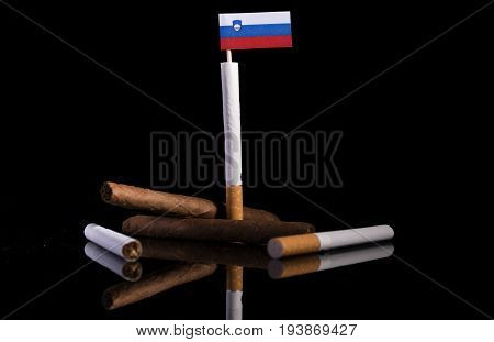 Slovenian Flag With Cigarettes And Cigars. Tobacco Industry Concept.