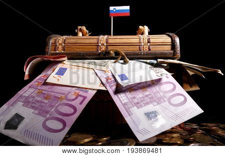 Slovenian Flag On Top Of Crate Full Of Money