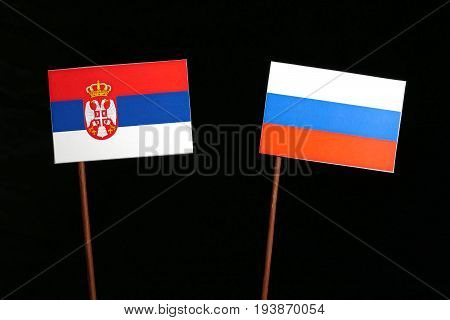 Serbian Flag With Russian Flag Isolated On Black Background
