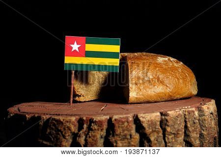 Togo Flag On A Stump With Bread Isolated
