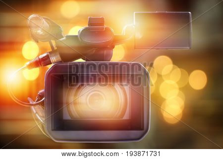 professional video camcorder in studio with blurred lighting background
