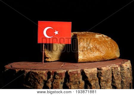 Turkish Flag On A Stump With Bread Isolated