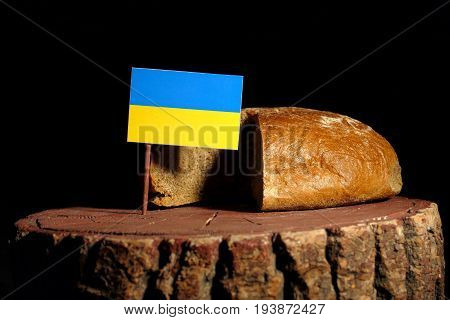 Ukraine Flag On A Stump With Bread Isolated