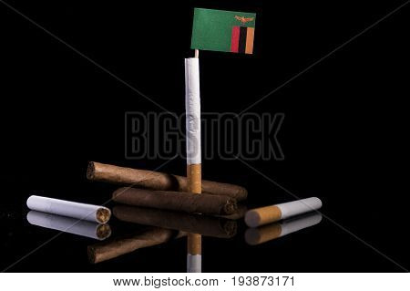 Zambia Flag With Cigarettes And Cigars. Tobacco Industry Concept.