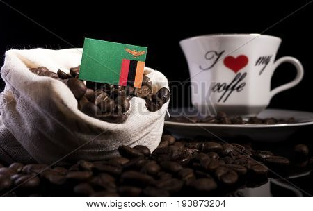 Zambia Flag In A Bag With Coffee Beans Isolated On Black Background