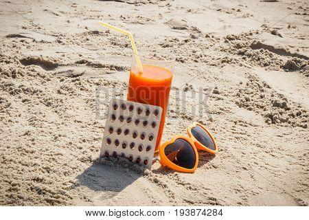 Medical Pills, Carrot Juice And Sunglasses At Beach, Vitamin A And Beautiful, Lasting Tan