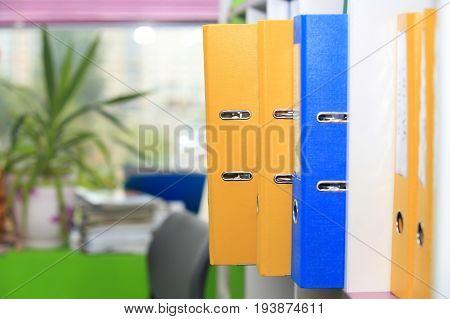 Folders in office. Folders on office window background.