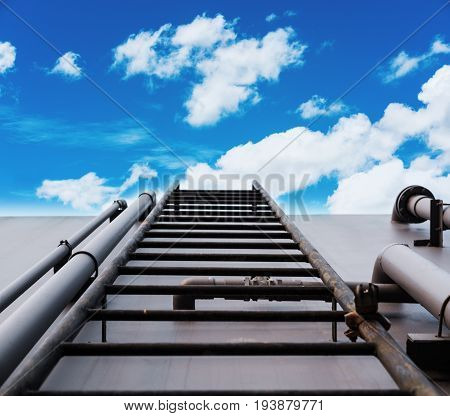 ladder on deck with blue sky and white clouds