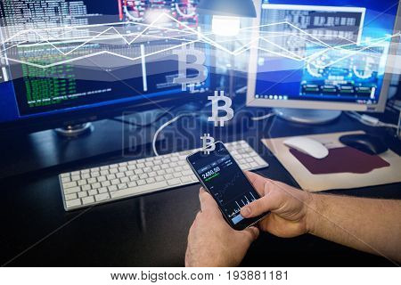 Man holding a phone with a bitcoin exchange rate. Concept