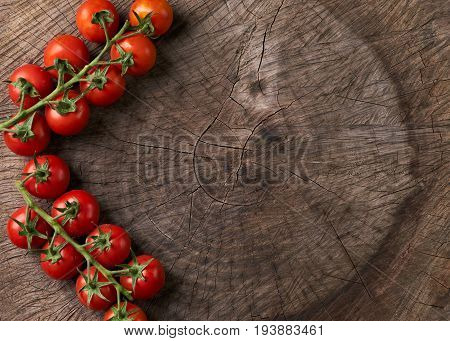 Top view of a Ripe tasty red tomatoes. Village market organic tomatoes on wooden board with copy space. View from above of Fresh tomato. Qualitative background from tomatoes. Detox contept