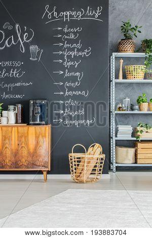 Creative chalkboard wall in the industrial kitchen