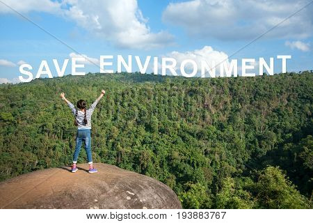 Joyful Young Asian girl holding hands and breathing fresh air outdoors. Save environment concept.