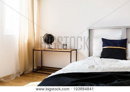 Modern design of grey headboard of cozy bed in white bedroom