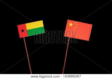 Guinea Bissau Flag With Chinese Flag Isolated On Black Background