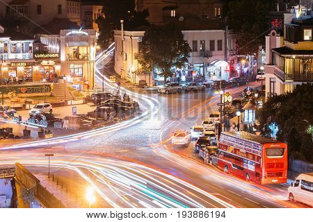 Tbilisi, Georgia - October 21, 2016: Evening Night Scenic Aerial View Of Historic District Abanotubani. Night Traffic On Vakhtang Gorgasali Square. Popular Place For Locals And Tourists