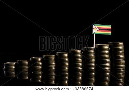 Zimbabwean Flag With Lot Of Coins Isolated On Black Background