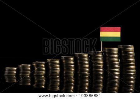 Bolivian Flag With Lot Of Coins Isolated On Black Background