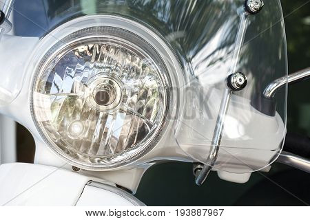Motorcycle or Scooter headlight lamp with daylight lamp turned on and windshields for transportation or technology concept design.