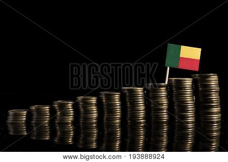 Benin Flag With Lot Of Coins Isolated On Black Background