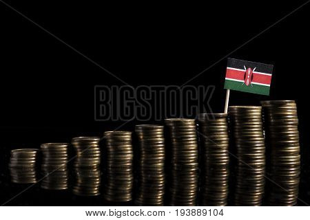 Kenyan Flag With Lot Of Coins Isolated On Black Background