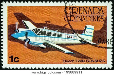 Moscow Russia - July 04 2017: A stamp printed in Grenada shows small passenger aircraft Beech Twin Bonanza series circa 1976