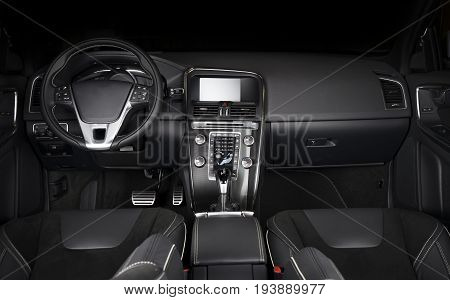 Modern sport car interior dashboard dark contrast light