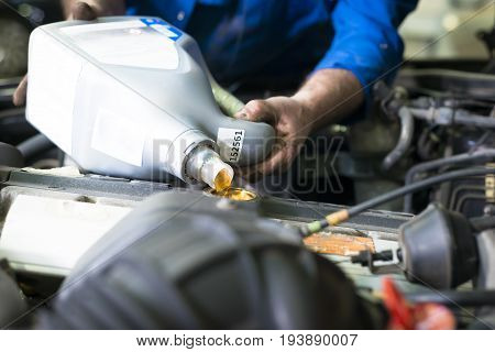 Car engine servicing, oil and filter replacing maintenance