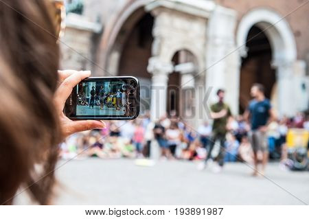 Girl Realizes Video Clip With Her Smartphone During Street Performances At The Busker Festival In Fe