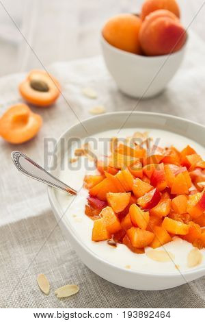 Yogurt with diced apricots and almond slivers