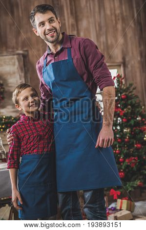 Father And Son In Blue Aprons