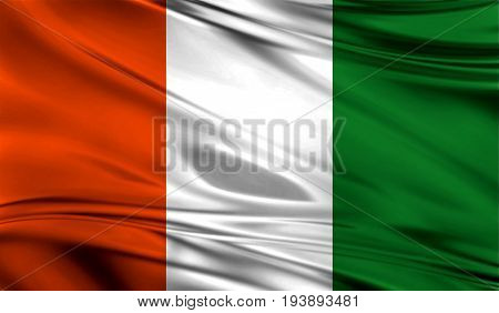 Realistic flag of Cote d,lvoire on the wavy surface of fabric. This flag can be used in design