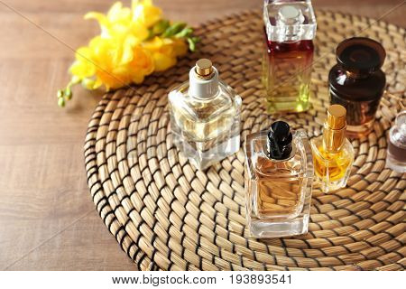 Set of perfume bottles on rattan placemat