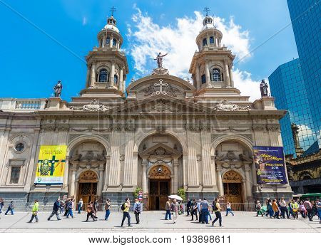 SANTIAGO CHILE - OCTOBER 23 2016: People on Plaza de Armas in front of Santiago Metropolitan Cathedral. This is the main sguare of the city surrounded by historic buildings.