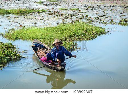 People Rowing Boat On The Lotus Lake
