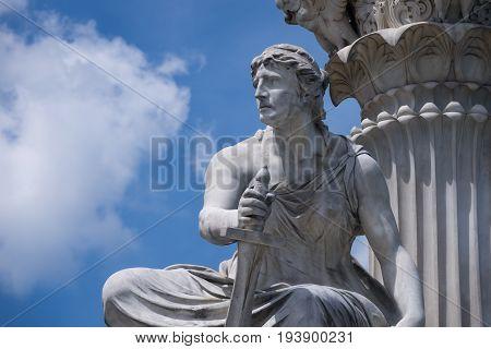Classical Greek Figurine sculpture at Pallas Athena Fountain in Vienna