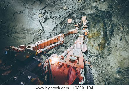 Gold mining deep underground, drilling the tunnel