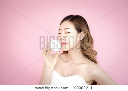 Young Beautiful Korea Woman Holding Product In Hand With Relax Emotion At Pink Background, 20-30 Yea