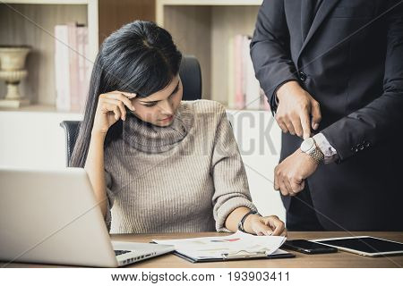 Upset Woman Being Scolded By Boss For Working At Office, Boss Showing Time For Deadline Job, Woman W
