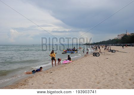 PHETCHABURI, THAILAND - JULY 18, 2016: unidentified Tourists and locals enjoy their holiday beach of cha am beaches are the tourist attraction places of Thailand.