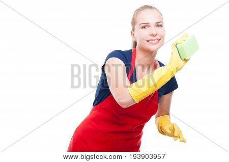 Young Housewife With Sponge Cleaning The House
