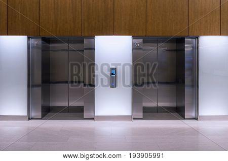 Double elevators in department, Indoor elevator door