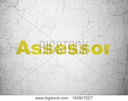 Insurance concept: Yellow Assessor on textured concrete wall background