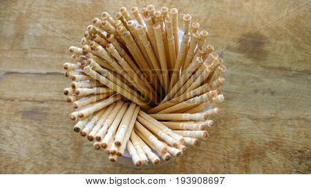 abstract wooden tooth picks on wood background